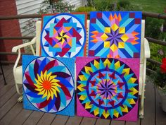 four 2' x 2' little barn quilts