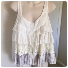 "FESTIVAL Millau LF ruffle lace tank top This is a Millau top from LF. It is a white multi-tiered lace and cotton tank top. It is new and has no flaws. Size small but will fit a medium. Bust 36"" length 25"". Made of 100% cotton.  TradesModeling ✅Smoke free home✅  ✅Offers considered✅ Please use the blue 'offer' button to submit an offer.   Bundle 2 or more items for an automatic 15% discount. Millau Tops Tank Tops"