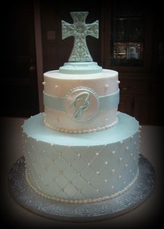 "Baptism Butter Cream Cake. Wrap around 6"" and circle is fondant. Cross is white chocolate."
