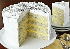 The Galley Gourmet: Lemon Poppy Seed Lady Cake. I just might try this cake for a special occasion. Just Desserts, Delicious Desserts, Yummy Food, Sweet Recipes, Cake Recipes, Dessert Recipes, Cupcakes, Cupcake Cakes, Macaroons
