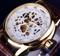 Find More Casual Watches Information about Winner Skeleton Automatic Mechanical Watch High Grade Leather Strap Gold Watch Mens Watch Top Brand Luxury Erkek Saat Male Clock,High Quality watch holder,China clock wrist watch Suppliers, Cheap watch strass from GMT on Aliexpress.com