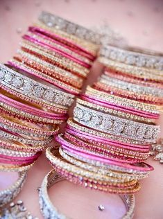Blinged out bangles! The coral, pink, gold and silver combination is amazing!