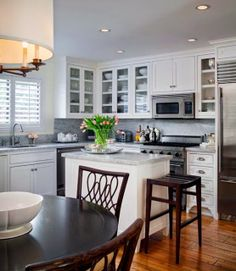 small galley kitchen design ideas Make use of the center of your kitchen. Create an island in the center of the kitchen that can provide storage that is also convenient from any spot in the kitchen.