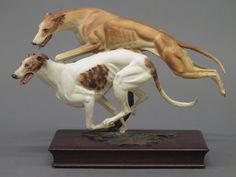 Albany, a limited edition figure group of 2 greyhounds, raised on a mahogany case 11""