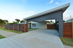 A new angle on the carport roof adds a contempory feel to this home. The concrete driveway was cut to look like paving. Concrete Driveways, Building Companies, Custom Design, Garage Doors, New Homes, Budget, Construction, Outdoor Decor, Home Decor