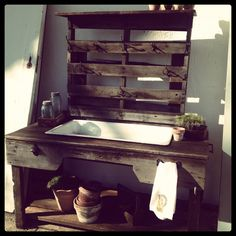 Potting bench made from pallets, barnwood and vintage cast iron sink. Added a bottle opener so it can be used for parties. Just fill sink with ice and beer!