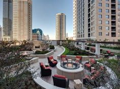 Outdoor lounge with a fire pit at AMLI River North, a luxury apartment community in Chicago.
