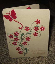 Good by and good luck card with red glittery butterfies and flowers