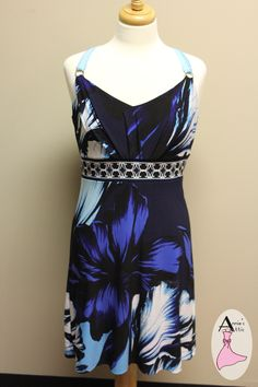 White House Black Market dress, size SMALL Black, blue, turquoise and white Detailed band around waist Tie closure at top back of dress Polyester, spandex blend $34.00
