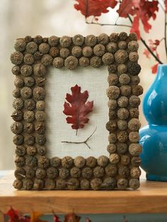 Spruce up an inexpensive crafts store frame with a trim of acorn caps affixed with hot glue. An oak leaf and twig glued to burlap make a fitting focal point.