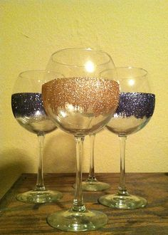 I like this! Possibly make these for the Bachelorette party goers. Glitter + cheap wine glasses + Mod Podge = stunning!....can put their names on them too...nice favor!