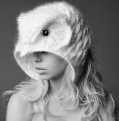 knitted owl hat on Blogger site knittingisawesome. Pity there's no pattern for this. It looks exceptional!