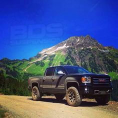 "2014 GMC Sierra All Terrain 1500 lifted with a 4"" BDS lift and 35's."