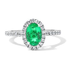 18ct White Gold Oval Emerald Cutdown Set Diamond Halo Engagement Ring