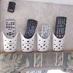 Soap holders organize remotes in an RV. I need add this to ours to handle iPods  cell phones.