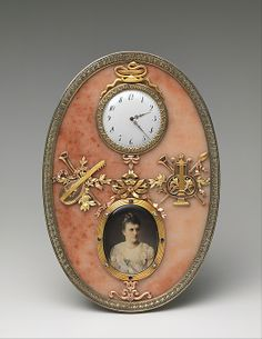 Imperial Frame and Clock, by Fabergé, workmaster: Mikhail Evlampievich Perkhin, painting by Johannes Zehngraf; before 1899, in rose jasper, silver gilt, trois-couleur gold, diamond, sapphire, ivory, oil paint, glass. Provenance: Created for Tsarina Alexandra Feodorovna ; Commissioned for Princess Albert of Sachsen-Altenburg.