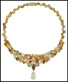 A natural fancy colored diamond necklace comprised of 117.42 carats of fancy colored diamonds and suspending an 8.5 carat diamond drop. Via Diamonds in the Library.