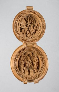 Boxwood rosary bead with the Adoration of the Magi and a Pietà with St. James the Greater and St. Ursula, c. 1480-1530