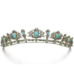 Turquoise and diamond tiara/necklace, late 19th century. Designed as a graduated series of palmette motifs, each set with a cabochon turquoise within a surround of circular-cut diamonds, mounted on a line of figure-of-eight links, detachable into a necklace and five clip brooches, detachable tiara frame, five brooch clip fittings. #antique #tiara #necklace