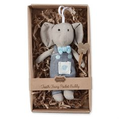 Mini plush and linen tooth fairy elephant holds tooth shaped wand and wears chambray overalls featuring small pocket to hold tooth. Hangs from grosgrain ribbon.