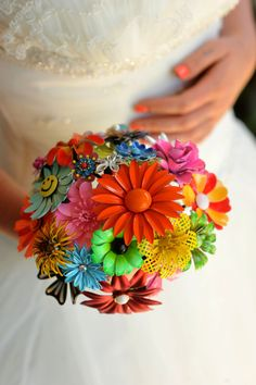 If rhinestones aren't for you and you love the retro vintage look... Bouquet created from retro brooches.  Colorful!  Repurpose, recycle, upcycle!  For ideas and goods shop at Estate ReSale & ReDesign, LLC in Bonita Springs, FL