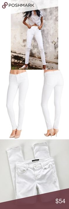 """J Brand Mid Rise Rail 8112 Jeans Sz 30 Great jeans from J Brand - a chic white denim look will add versatility to your wardrobe. These are a slimming mid-rise Skinny Jean silhouette.  Style 8112C028 DETAILS Straight Mid-Rise 13"""" Inch Leg Opening 30.75"""" Inseam 9.25"""" rise front 14"""" back rise 11-Ounce Super Soft Stretch Denim 90% Cotton, 8% Polyester, 2% Elastane Designed in the USA J Brand Jeans Straight Leg"""