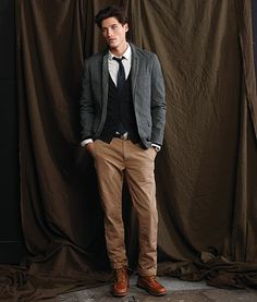 J. Crew - grey jacket, black cardigan, white shirt, navy tie, black belt, brown pants, brown moccasin toe boots