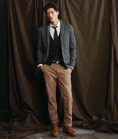 J. Crew - grey jacket, black cardigan, white shirt, navy tie, black belt, brown pants, brown moccasin toe boots