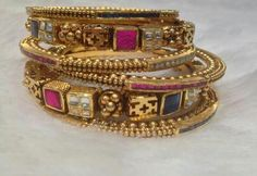 Indian bangles in gold and precious stones. Shop for your wedding jewellery with… Gold Bangles Design, Gold Jewellery Design, Gold Jewelry, Jewelery, Indian Wedding Jewelry, Bridal Jewelry, Or Antique, Antique Jewelry, India Jewelry