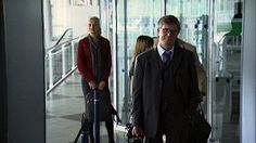 Stock Footage |MS Businesspeople putting luggage on x-ray machine and walking through metal detector at airport security checkpoint/ Munich, Germany | License and download using the VidLib iOS app with over 100.000 Royalty Free Clips