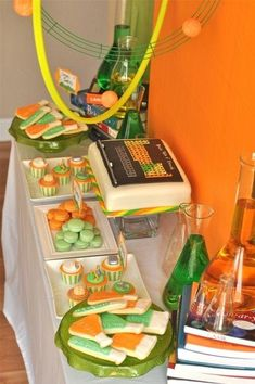 This science birthday party on a budget uses bright orange and green to put guests in the mood of a mad scientist's lab.