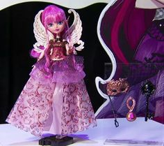 The Ever After High Thronecoming C. Cupid doll is dressed for the Thronecoming dance, instead of Doll Face Paint, Ever After Dolls, Doll Videos, Raven Queen, Disney Princess Pictures, Briar Rose, Halloween Doll, Ever After High, Monster High Dolls