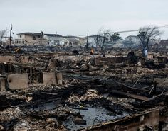 Desolate residents walk through Breezy Point, Queens, after Hurricane Sandy laid waste to the neighborhood.    Bryan Pace for New York Daily News