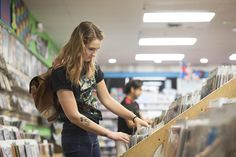 A young woman searches for records at Kool Daddy Records in St. Petersburg, Fla.