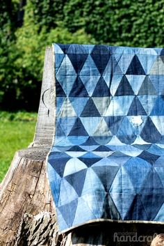 Denim Triangle Quilt Created using old jeans and a simple triangle quilt pattern, this quilt measures 53″ x 77″