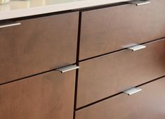 "We have cabinet and drawer pulls! (brand is Berenson, style is ""Bravo"" and cabinets are by Decora)"