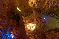 Unique en Europe, les Moulins Souterrains du Col-Des-Roches ont la particularité de se trouver sur et dans des grottes.