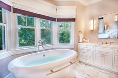 This spacious bathroom is calm, serene and will make anyone relax after a stressful day. Decor, House, Spacious Kitchens, Home, Porch Fireplace, Clawfoot Bathtub, Contemporary Decor, Bathroom, Spacious