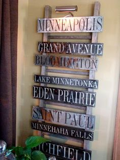 Love this!!!!  I want to do this for all the places I have lives.      This creative take on a Bus/Subway Sign is great- using an old ladder as a display base for the signs.