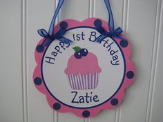 Door sign except in pink and purple or a blue to match her cake and invites