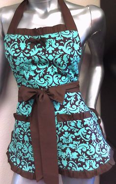 This is a good example of an apron i like. I like an apron with tie strings at top and bottom so sizing can be adjusted.