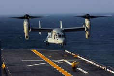 """ATLANTIC OCEAN (July 8, 2008) A V-22 Osprey aircraft from the """"Thunder Chickens"""" of Marine Medium Tiltrotor Squadron (VMM) 263 conducts landing qualifications aboard the multi-purpose amphibious assault ship USS Bataan (LHD 5). Bataan is conducting routine operations in the Atlantic Ocean. U.S. Navy photo by Mass Communication Specialist 3rd Class Patrick Gearhiser"""