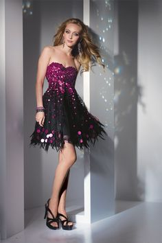 In the party mood with this sparkle and fade fringe short dress. Fully sequined with large paillettes on the bodice and down to skirt. Dance like a star with this net skirt with fringe on the hem.   Style 4224