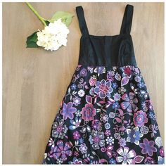 Ann Taylor sundress Ann Taylor loft, fully lined sundress with bold floral print with side zipper cute tie in the back. Also stretchy in the back for a little give. Falls just above the knee, worn once- great condition! Shell: 100% cotton. Lining: 100% cotton Ann Taylor Dresses Midi