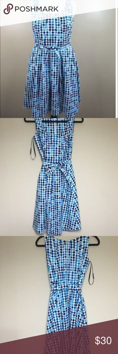 Calvin Klein dress Cute white dressw/shades of blue polka dots. Zipper up the middle of the back. Pleated design on top. 97% cotton and 3% spandex Calvin Klein Dresses Midi