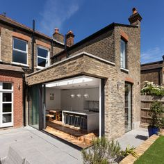 British architecture firm Russian For Fish, has designed the expansion and remodel of a traditional Victorian house in London, for a family who wanted to enhance its connection to the garden, and create a kitchen where they could come together to dine. British Architecture, Modern Architecture, Brick Extension, Green Subway Tile, Oak Parquet Flooring, Modern Entry, House Extensions, Sliding Glass Door, Victorian Homes