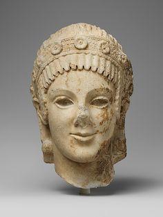 Marble head of Athena.  Period:     Augustan or Julio-Claudian Date:     ca. 27 B.C.–A.D. 68 Culture:     Roman Medium:     Marble, Island