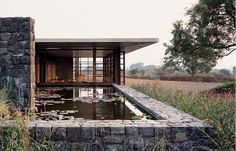Designed by Studio Mumbai, the house communes with the natural world, a refuge from the chaos of the nearby city.