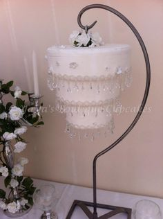 "Hanging Chandelier cake . I don't really like it but I can't take my eyes off it...I think it's because I'm thinking ""that's going to fall"" and it makes me nervous!!! Shaz"