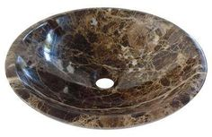 Round Spanish Dark Emperador Marble Counter Top Basin. A stone washbasin with a smooth polished finish for a modern designer look.